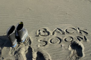 back soon in sand